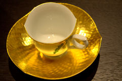 Golden coffee cup Royalty Free Stock Images