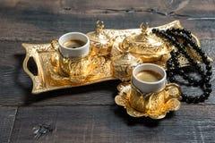 Golden coffee cups rosary beads Ramadan kareem Royalty Free Stock Photos