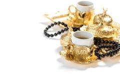 Golden coffee cups rosary Islamic holidays Ramadan kareem Stock Photos