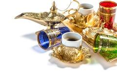 Golden coffee cups tea glasses white background Arabic lantern Royalty Free Stock Image