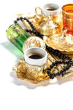Golden coffee cups tea glasses white background Ramadan Royalty Free Stock Photography
