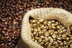 Golden coffee seeds in sack stock photos