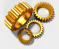 Golden cog gears over white Stock Photography
