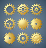 Golden cogwheels Stock Photo
