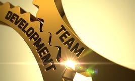 Golden Cogwheels with Team Development Concept. 3D Stock Images