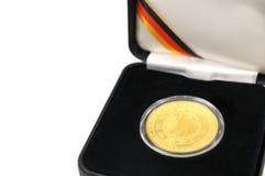 Golden Coin. Golden 100 Euro coin in satin case Royalty Free Stock Photography