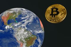 Golden coin bitcoin is flying in the space to the earth. stock photography