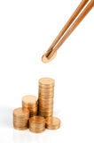 Golden coin and chopstick Stock Photography