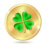 Golden coin with clover Stock Photos