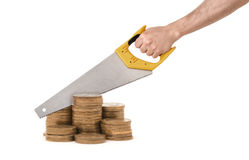 Golden coin columns on white background and giant hand with saw trying to divide it Stock Image