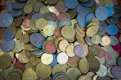 Golden coin and old coin royalty free stock image