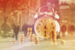 Golden coin stack and vintage clock Royalty Free Stock Photography