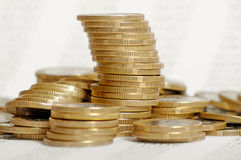 Golden coin stacks on background with numbers Stock Image