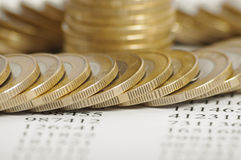 Golden coin stacks on background with numbers Royalty Free Stock Photography