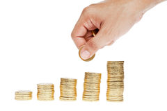 Golden coin stacks and hand Stock Photography