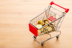Golden coin in trolley Royalty Free Stock Photo