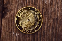 Golden coin Tron TRX, digital money, new cryptocurrency. Tron is a promising cryptocurrency stock images