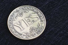 Golden coin with the word Yes on dark black background using as coice or fortune in life or decision in life, gambling or lucky. Coin stock photos