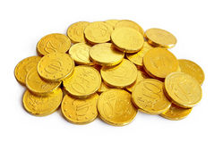 Golden coins. Pile of chocolate coins wrapped in shiny golden tinfoil royalty free stock photos