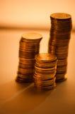 Golden coins. Three stacks. Closer-up Royalty Free Stock Photos