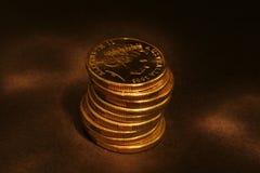 Golden coins. Golden Australian coins Stock Photos