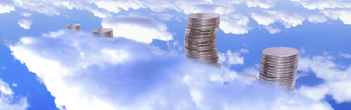 Golden coins against the blue sky. Background Stock Photography