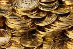 Golden coins background Stock Images