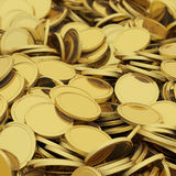 Golden coins background. Golden scattered coins closeup background. Selective DOF Royalty Free Stock Image