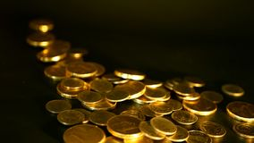 Golden coins on black background. Success of finance business, investment,monetization of ideas, wealth, banking concept. Management efficiency. Golden coins on stock video footage