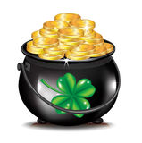 Golden coins in black pot and clover Royalty Free Stock Image