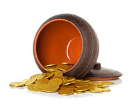 Golden coins in ceramic pot Royalty Free Stock Photo