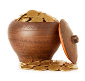 Golden coins in ceramic pot Royalty Free Stock Photos