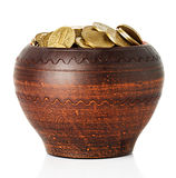 Golden coins in ceramic pot Royalty Free Stock Image