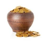 Golden coins in ceramic pot Stock Image