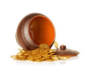 Golden coins in ceramic pot Stock Images