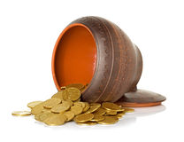 Golden coins in ceramic pot Royalty Free Stock Images