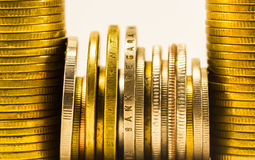 Golden coins and coins stacked in each other in different positi Stock Photos