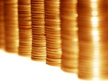Golden coins. Column of golden coins isolated on white Royalty Free Stock Images