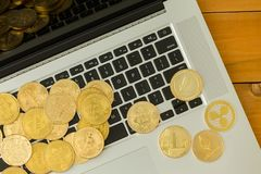 Golden coins of cryptocurrencies over laptop royalty free stock images