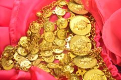 Golden coins on dress Stock Photo