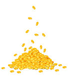 Golden coins dropping down on pile Royalty Free Stock Photography