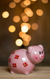 Golden coins entering the piggy bank royalty free stock photo