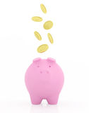 Golden coins falling to pink piggy bank. Stock Image