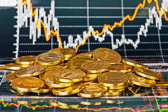 Golden coins and financial chart as  background Stock Photos