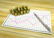Golden coins on financial chart pape Stock Image
