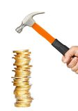Golden coins and hammer in man hand isolated on white Stock Photography