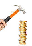 Golden coins and hammer in man hand isolated on white Royalty Free Stock Images