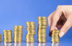 Golden coins and hand is building coins Royalty Free Stock Photo