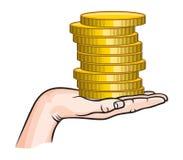 Golden coins in hand Stock Photos