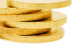 Golden coins isolated over white Stock Photography